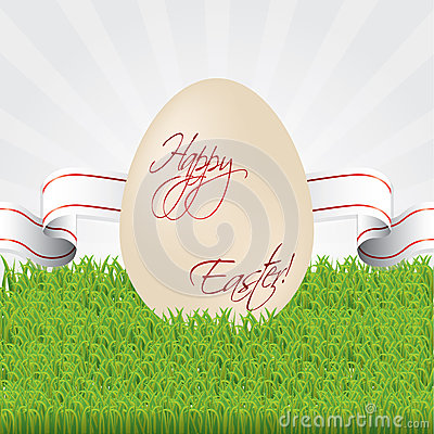 Easter egg with ribbon in grass