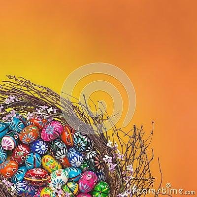 Easter Eggs basket arrangement on orange