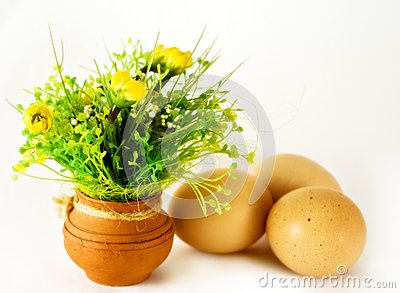 Easter - eggs and ceramic vase with flowers