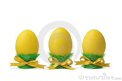 Easter eggs in egg-cups isolated on white
