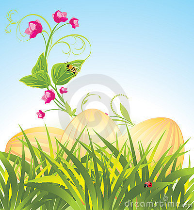 Easter eggs in the grass with flowers