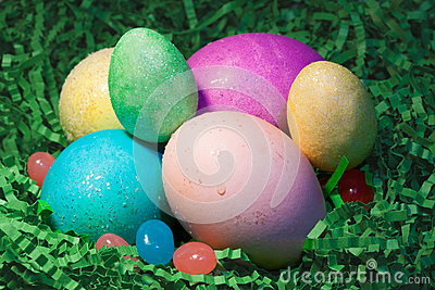 Easter Eggs in Grass with Jelly Beans Stock Photo