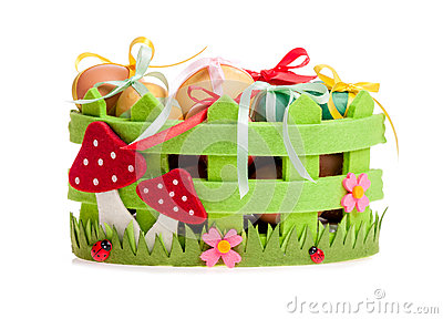 Easter eggs in the green decorative basket