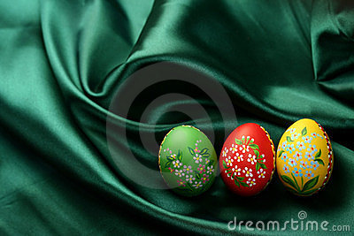 Easter Eggs on Green Satin Fabric