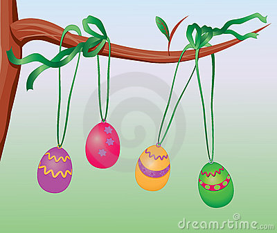 Easter eggs hanging on a tree branch