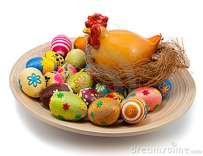 Easter eggs and hen with nest on plate