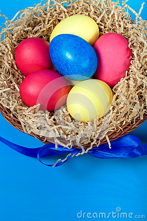 Free Easter Eggs In A Nest On Blue Background. Toned Stock Photo - 66077280