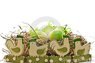 Easter eggs in nest and chickens