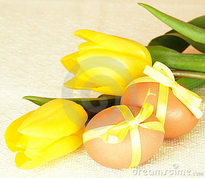 Easter Eggs with Yellow Ribbon Bows and Tulips