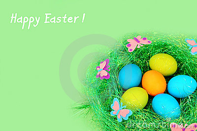 Easter painted eggs on a green background