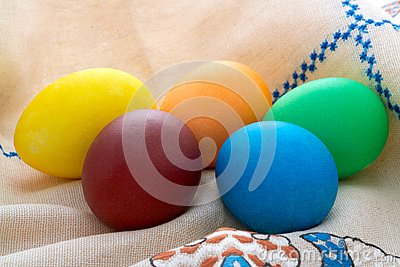 Easter  painted eggs on unbleached linen with embr