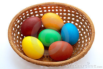Easter  painted eggs in webbed wooden plate