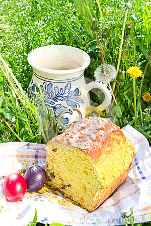 Easter panettone, eggs and jug with compote Stock Photo