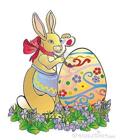 The easter rabbit paints egg