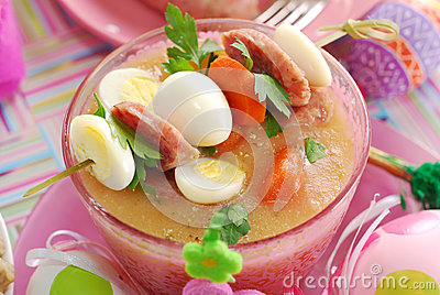 Easter white borscht with quail eggs and sausage in pink glass