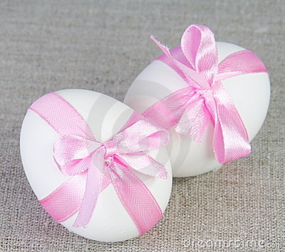 Easter White Eggs with Pink Bows on Sacking
