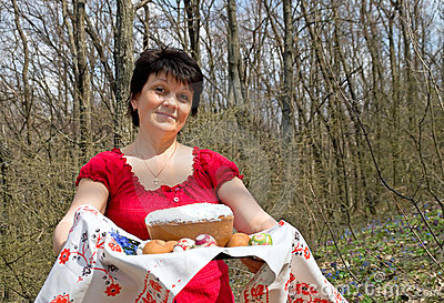 Easter. Woman with Easter cake