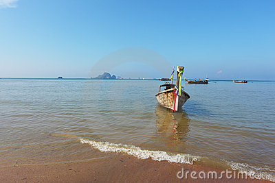 Easy Longtail boat dropped anchor in beach sand
