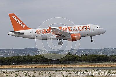 Easyjet Airbus Landing - Airplane, Faro, Portugal Editorial Stock Photo