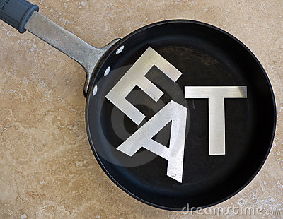 EAT spelled out in frying pan