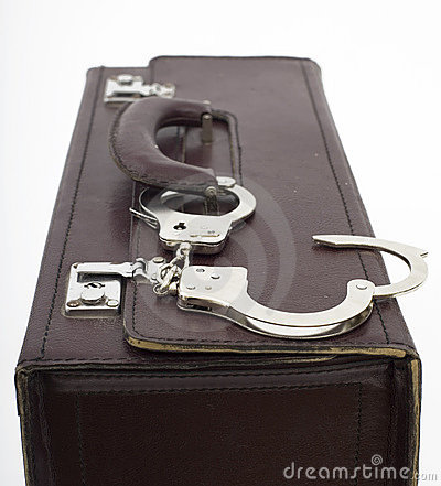 Eather suitcase from pinned open handcuffs