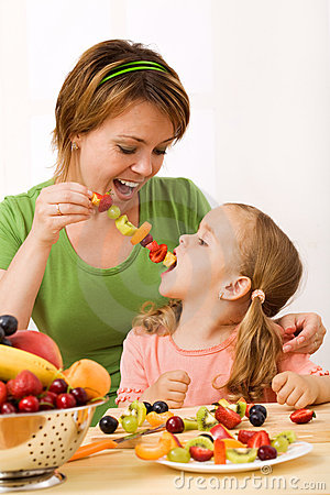 Free Eating A Healthy Snack - Fruit Slices On Stick Royalty Free Stock Photo - 9839895