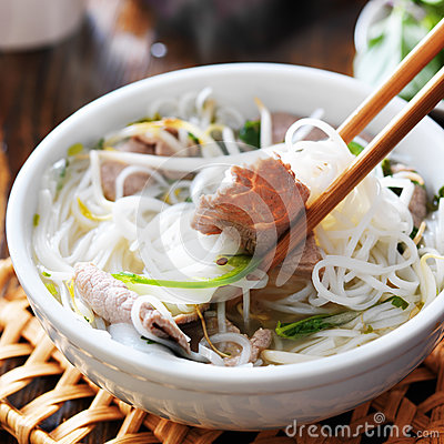 Free Eating A Steamy Bowl Of Pho Stock Images - 43366844
