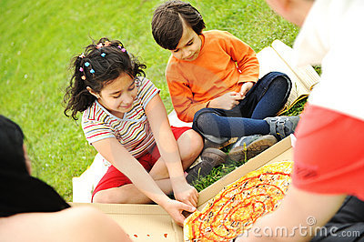 Eating pizza, picnic