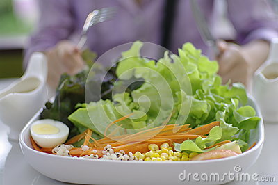 Eating salad, healthy meal