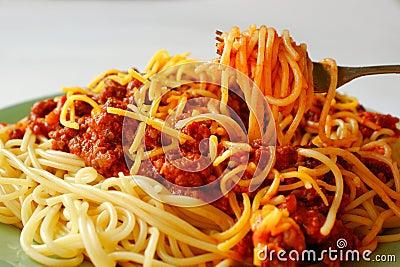 Eating spaghetti alla bolognese