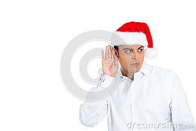 Eavesdopping mean young man in santa hat