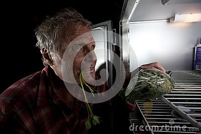 Eccentric Man Staring Into Refrigerator With Green