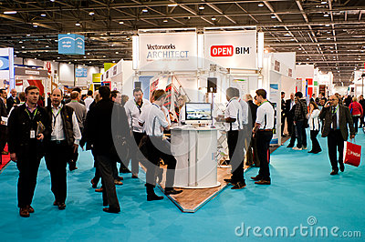 Businessmen visit a crowded fair Editorial Stock Image
