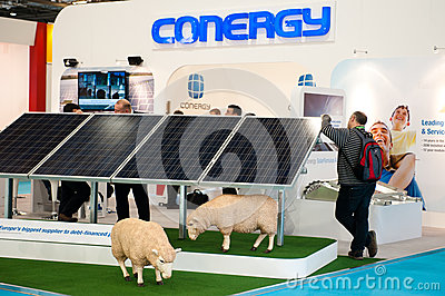 A visitor leans against solar panels at a sustaina Editorial Photography