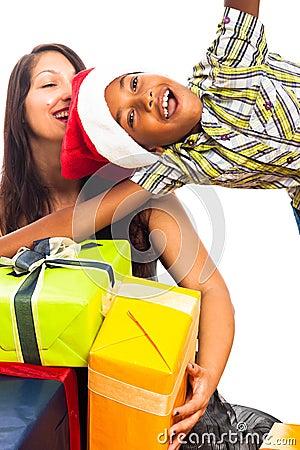 Ecstatic boy and woman celebrating Christmas