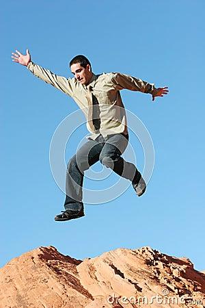 Ecstatic business man jumping