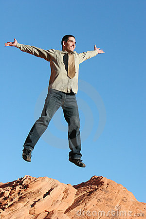 Ecstatic businessman jumping