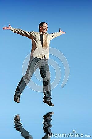 Ecstatic businessman jumping i