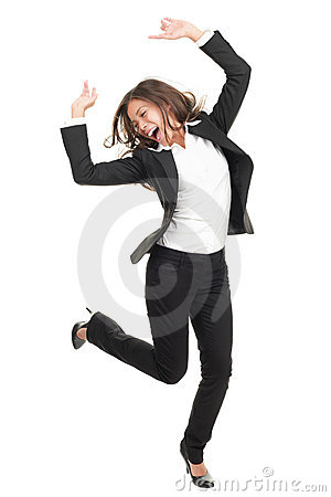Free Ecstatic Businesswoman In Suit Dancing Stock Photography - 13300952