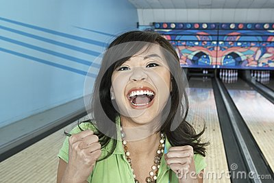 Ecstatic Female At Bowling Alley