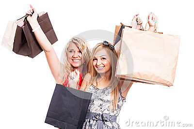 Ecstatic girls with shopping bags