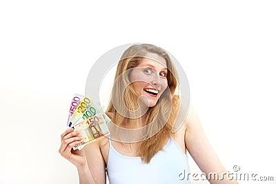 Ecstatic woman brandishing euro banknotes