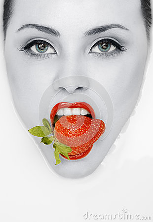 Ed lips with strawberry. Fashion toned portrait