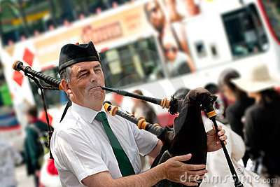 Edinburgh street bagpiper Editorial Stock Photo
