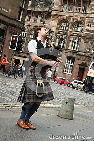Edinburgh street bagpiper Editorial Stock Photo