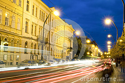 Editorial night scene boulevard car tram light streaks historic Editorial Stock Photo