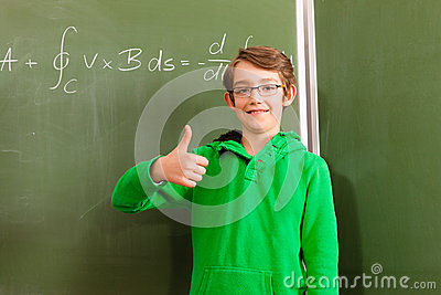 Education - Child or pupil at blackboard in school