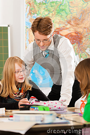 Free Education - Pupils And Teacher Learning At School Stock Photos - 35450773