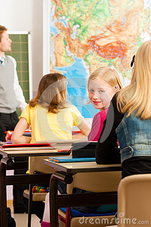 Free Education - Teacher With Pupil In School Teaching Stock Photo - 32787540