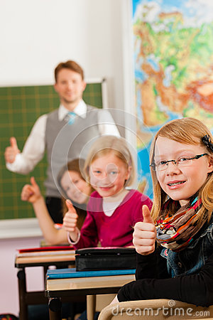 Free Education - Teacher With Pupil In School Teaching Stock Images - 35771754
